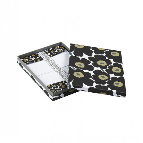 Opened decorative box with black beige and gray unikko floral pattern. Inside of box shows stacked envelops with the same pattern secured with belly bands with the brand name in a repeating pattern
