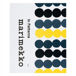 White book cover with slate gray black and yellow linked dot pattern along the right and a vertically aligned title on the left