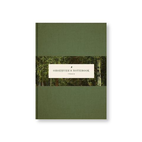 Deep green notebook cover with belly band featuring the title in a green vintage font surrounded by a colorized photo of a forest