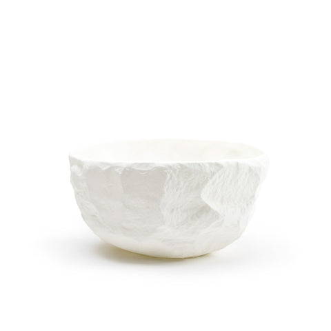 White serving bowl, with uneven chiseled texture on its exterior, shot on a white background.