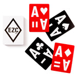 EZC Playing Cards are large print cards that are easy to read, and have numbers with codes, so those with vision impairments can tell what the cards are. Large white text on the playing cards measures at 1.5 inches. The base color of the cards are bright red or black.