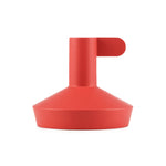 short red funnel-shaped candle holder with a narrow finger hold