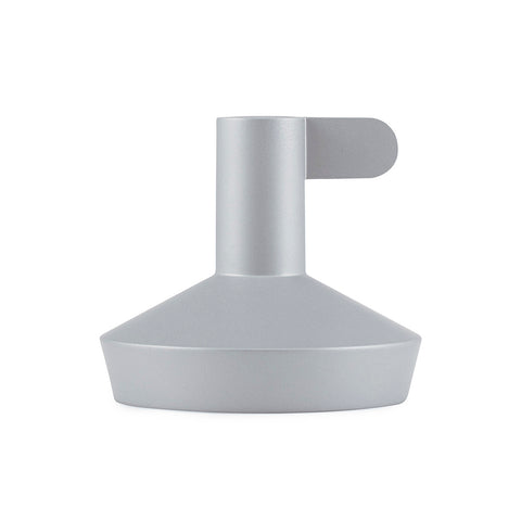 short silver funnel-shaped candle holder with a narrow finger hold