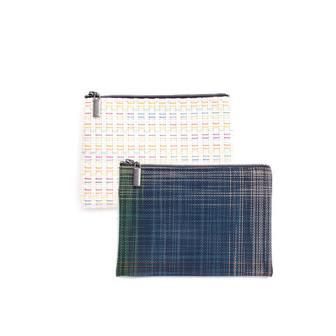 Two medium woven vinyl Chilewich zip pouches on white background.