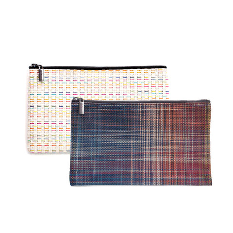 Two large woven vinyl Chilewich zip pouches on white background.