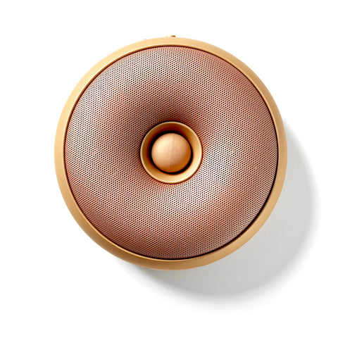 Bronze colored donut-shaped speaker.