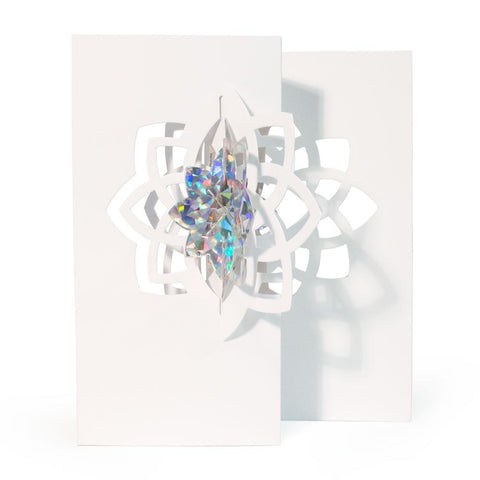 Three dimensional card made up of die cut crystal shapes with a holographic center.