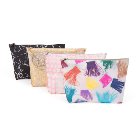 Four translucent cosmetic bags with scrap fabric as detailing