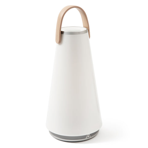 Uma Sound Lantern on a white background, with tapered, conical body, rounded silver speaker base, flat silver rimmed speaker/dimmer top and graceful U-shaped wooden carrying  handle.