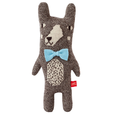 Knitted brown and white checked bear with a speckled tummy, white snout, brown nose, white cheeks, shortish arms and legs, and attached  light blue bow tie.