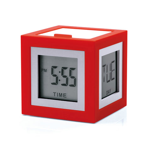 Red cube with small displays on each face, screen is framed in a narrow white frame. Two visible screens display the date and day of the week.