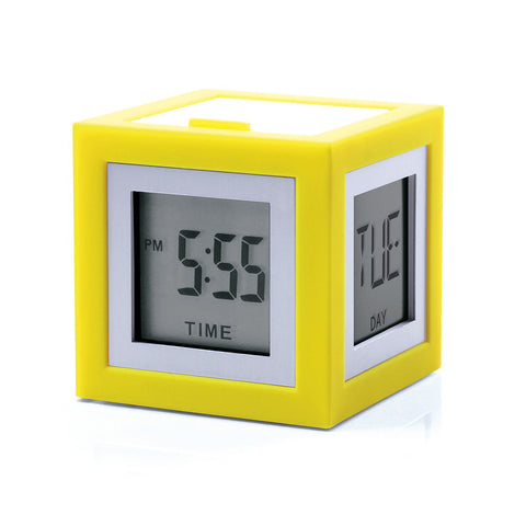 Yellow cube with small displays on each face, screen is framed in a narrow white frame. Two visible screens display the date and day of the week.