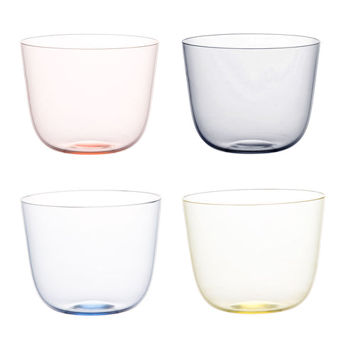 4 transparent water glasses in magenta, gray, blue, and yellow.