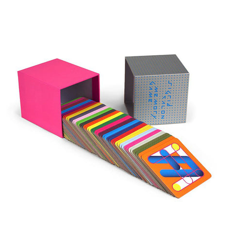 Opened cube box with hot pink bottom and gray top with blue dot design. Emerging from the bottom is a fan of square cards with colorful designs