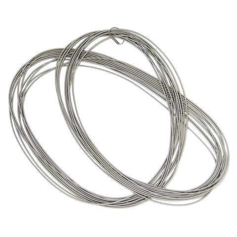 This long minimalistic necklace is assembled from ten stainless steel springs. It can be wrapped twice around the neck.