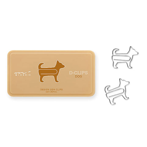 Tan container with brown dog image on front. Two dog-shaped metal silver paper clips lay flat next to container.