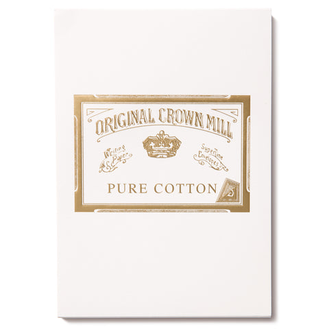 Image of a white writing pad. On the front of pad is an Original Crown Mill gold seal featuring a crown and an Old English font.