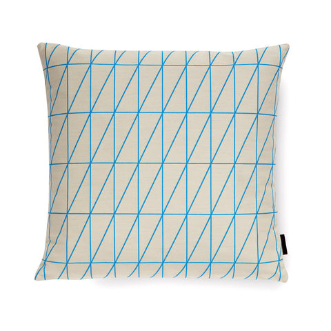Square-shaped pillow with embroidered detail of bright blue angled grid on a neutral colored backdrop