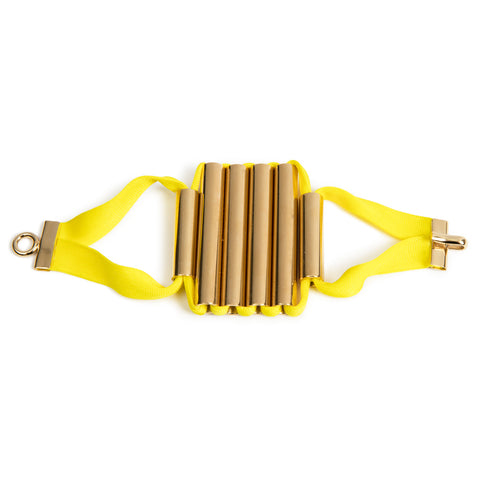 Bracelet designed from six golden tubes tight up together as a centerpiece by yellow ribbon, with a golden clasp at both ends.