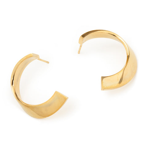 A pair of golden earrings in the shape of semicircles.