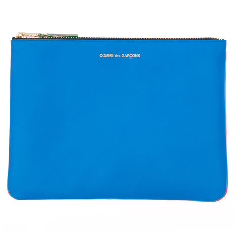 Bright blue leather pouch with top zip and embossed lettering on top border.