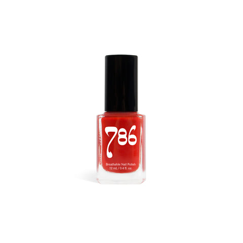 A bottle of bright red nail polish. The company logo is printed, in white, on the front of the bottle.