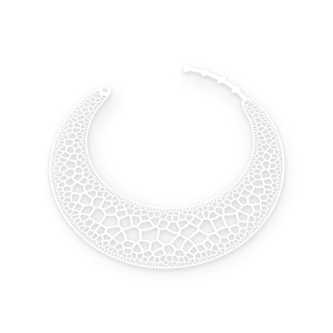 A crescent moon-shaped flat rubber necklace in white. The necklace is laser cut with rounded edges and lace like detail in its center  that is also laser-cut.