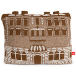 Plush, knitted pillow in brown and white with four small protruding chimneys at the top, with an image of  the original Carnegie Mansion.