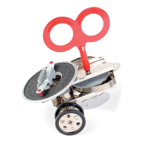 Close-up view of Sparklz Wind Up on a white background, showing wheels and gears, rough disk which creates sparks, and large red wind up key