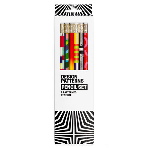 White and black box with dynamic angular pattern. Window in box shows six colorfully patterned pencils