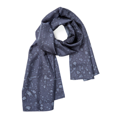 Made By Rain Scarf Small in Dark Blue, looped at the top with the ends hanging down. The material is silky, and splattered with raindrops.