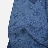 Detail of the rain splatters on the silky Made by Rain Scarf.