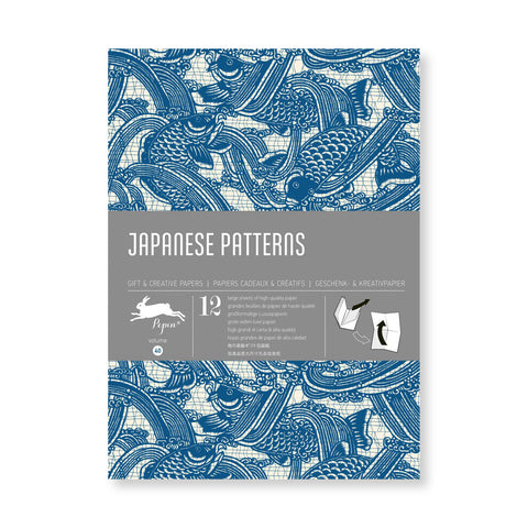 Wrapping paper book cover with pattern of indigo koi fish dancing among spurts of water. Title information in gray horizontal band across the middle