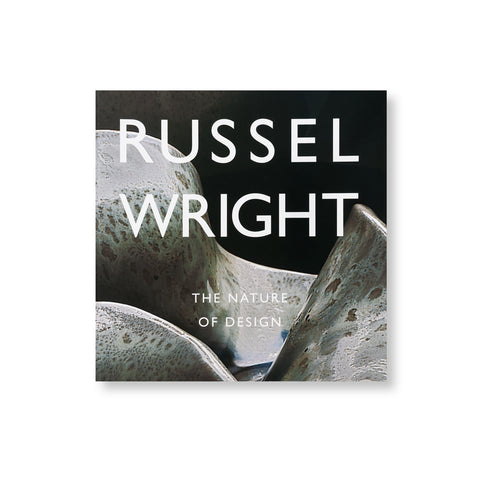 Square book cover with photograph of undulating ceramic form overlaid with title in white sans serif letters