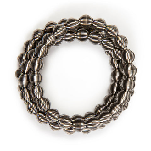 Circular bracelet made from interconnected stainless steel spring beads.