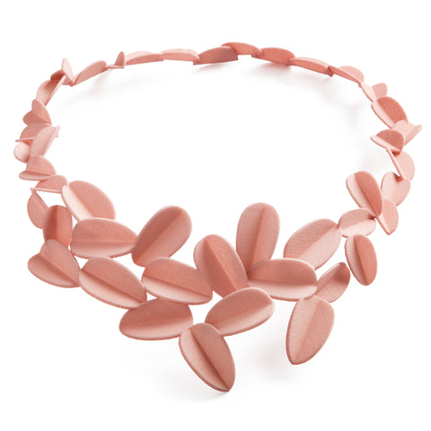 Simplified leaves combined in a natural pattern forming a circular shape of the necklace, dusty pink monochrome