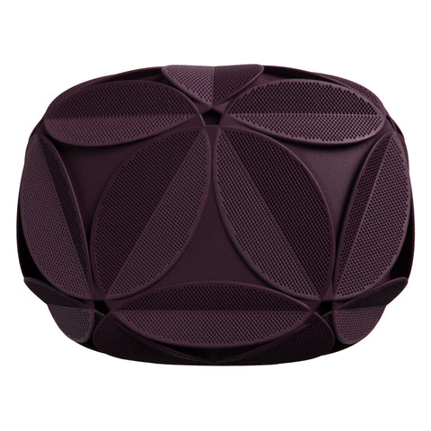 Purple clutch decorated with an elaborate pattern of sculptural plant leaves, each is perforated with tiny holes.