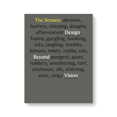 The Senses: Design Beyond Vision catalog on white background. Grey cover with text in yellow, black, and white.