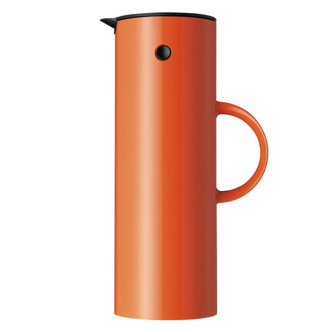 Profile view of the classic vacuum jug in bright orange Saffron, showing it's sleek, shiny surface,  tall minimal design, sleek cylindrical shape, and easy to hold side handle, with a black tilt-top lid and beak-shaped pour spout