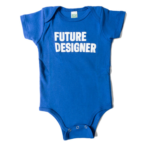 Baby's onesie in blue with white text that reads Future Designer across the chest area