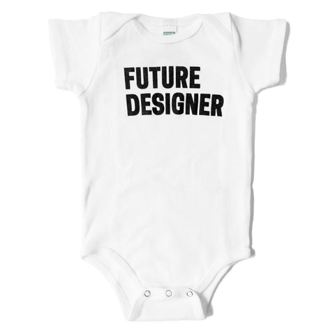 White baby onesie with bold text in black that reads 'FUTURE DESIGNER'