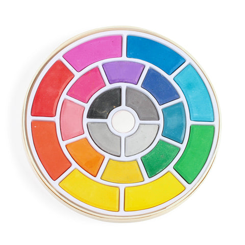 Watercolor pallet in the shape of a circle with the colors assorted in rainbow rings as black white and grey are centered.
