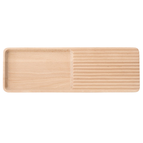 Rectangle tray in light wood with rounded edges. It is designed with two sections of a ribbed and a deepened surface.