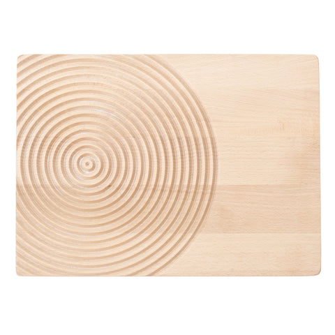 Rectangular serving board in light wood with rounded edges, decorated with circles that mimics the drop water splash rings on the left side.