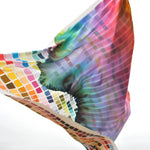 On Color Scarf. Various individually colored squares form a rainbow grid that has a dipped-in-water effect half way up