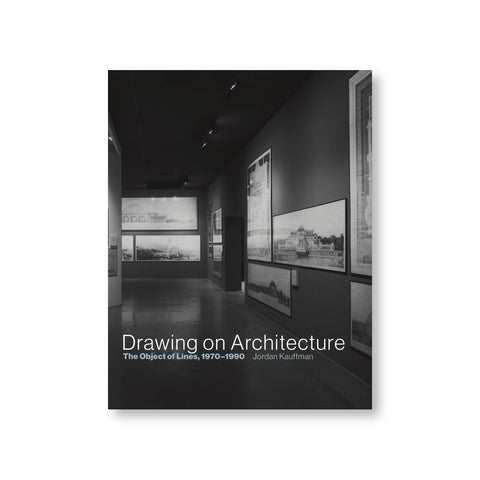 Book cover with black and white photograph of an exhibition gallery with large architectural drawings on paper in frames. Title near bottom