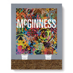 "Book cover with illustration in  collapsed perspective of a colorful artwork propped on two white plastic buckets over a veiny wooden floor in front of a gray wall. the word ""McGinness"" in tall white letters covers part of the artwork"