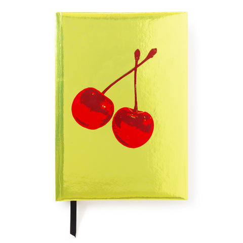 Glossy yellow notebook cover features two cherries in red at the center.