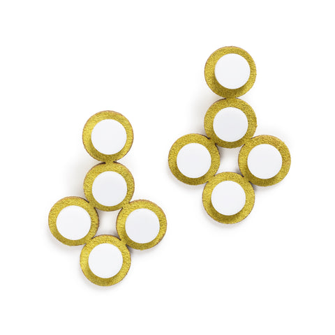 A pair of earrings, each one is designed from five connected laser-cut suede plates and decorated with five white acrylic disks on the front.