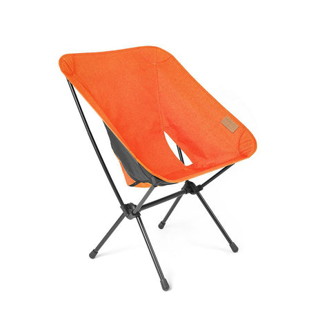 A square-shaped collapsible canvas chair  with an aluminum frame in orange.
